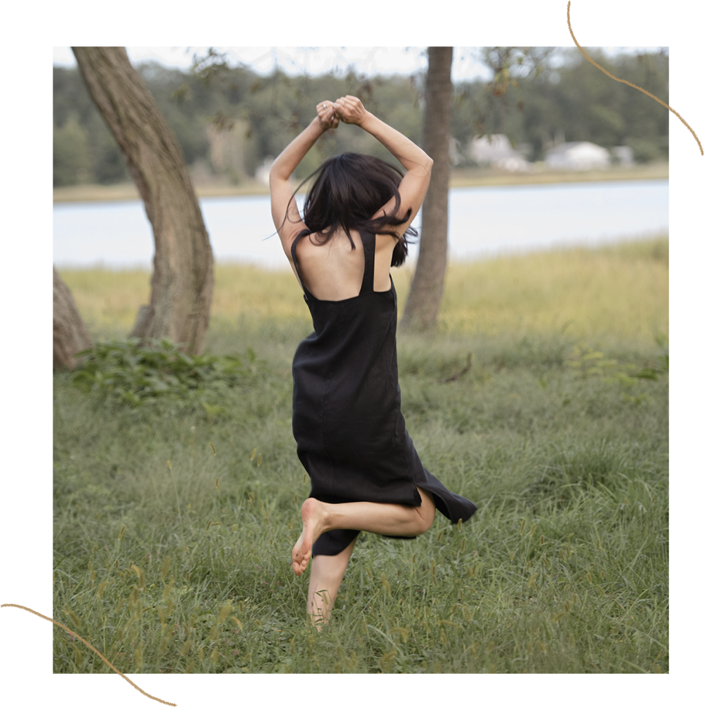 Jamie Mendell, jumping around in a field